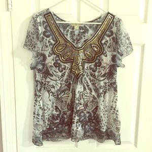 Live and let live, knit blouse with sequin.